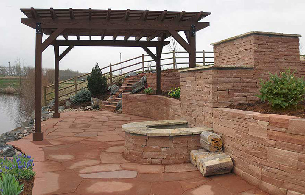 lakeside-Red-Sandstone-Patio,-Retaining-Wall,-Firepit-and-Arbor